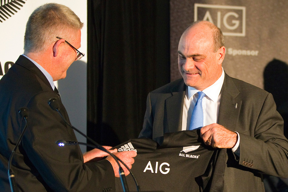New Zealand Rugby CEO Steve Tew presents AIG Insurance Executive Vice President Peter Hancock with a new team shirt following the announcement of a new global sponsorship deal with AIG Insurance which sees their brand on New Zealand's Representative Rugby Shirts, Auckland, New Zealand, Friday, October 12, 2012.  Credit:SNPA / David Rowland