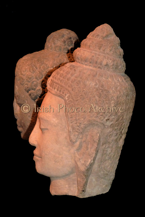 Head of the Buddha. 800-30, Shailendra dynasty, Central Java, Stone.  The head originally formed part of a large-scale image of Buddha Shakyamuni. The Shailendra rulers were strong supporters of Mahayana Buddhism and erected many Buddhist monuments in central Java, including the complex of Borobudur.