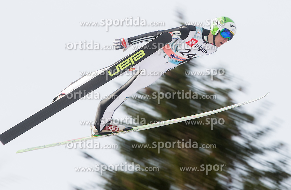 DEZMAN Nejc of Slovenia soars through the air during Large Hill Individual Competition at 2nd day of FIS Ski Jumping World Cup Finals Planica 2014, on March 21, 2014 in Planica, Slovenia. Photo by Vid Ponikvar / Sportida
