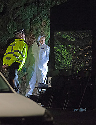 ©Licensed to London News Pictures 22/12/2019. <br /> Crawley Down ,UK. Police forensic officers working in the dark at the scene. Two people are dead and a third is fighting for life after a knife attack on a housing estate in Crawley Down, West Sussex Photo credit: Grant Falvey/LNP
