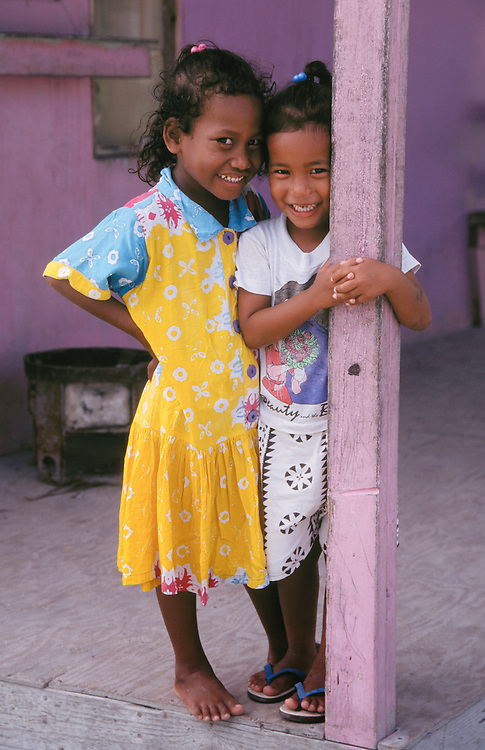 Marshall Islands, Micronesia: Two young Marshallese girls on porch of house in Uliga community of Majuro Atoll.