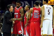 Feb. 11, 2011; Cleveland, OH, USA; Los Angeles Clippers head coach Vinny Del Negro yells at his team during a timeout during the third quarter against the Cleveland Cavaliers at Quicken Loans Arena. The Cavaliers broke their loosing streak beating the Clipper 126-119 in overtime. Mandatory Credit: Jason Miller-US PRESSWIRE