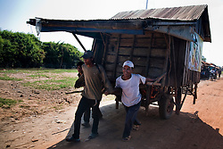 December 12, 2008 - Pursat, Cambodia. Villagers pull their house closer to the water as the Tonle Sap recedes. © Nicolas Axelrod / Ruom