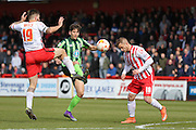 Connor Smith defender for AFC Wimbledon (18) gets caught between \s19 and Dean Wells defender for Stevenage FC (19) during the Sky Bet League 2 match between Stevenage and AFC Wimbledon at the Lamex Stadium, Stevenage, England on 30 April 2016. Photo by Stuart Butcher.