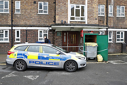 © Licensed to London News Pictures. 20/03/2017. London, UK.  Police attend the scene at a block of flats in Hoxton where a man's body was found. Officers found the victim, in his 20s, who  was unresponsive shortly after 12.30pm on Sunday. A murder investigation has been launched after a 28 year old man was arrested. Photo credit: Peter Macdiarmid/LNP