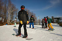 Good early season conditions greeted skiers and riders off Gunstock's Ramroad Quad lift Sunday morning as they hit the slopes for opening weekend.  (Karen Bobotas/for the Laconia Daily Sun)