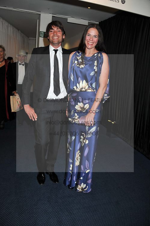 ALEX JAMES and his wife CLAIRE NEATE at the GQ Men of The Year Awards 2012 held at The Royal Opera House, London on 4th September 2012.