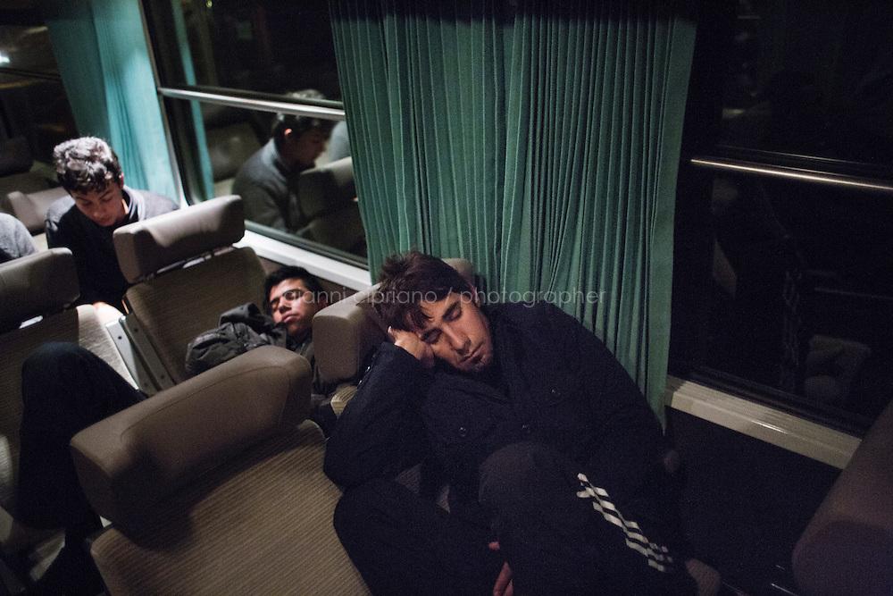 EVRY, FRANCE - 19 NOVEMBER 2014: Syrian refugees sleep on the Night Intercity Train from Nice to Paris, in Evry, France, on November 19th 2014.<br /> <br /> After crossing the Italian-French border, migrants take the train to Paris. Some stop in Paris, but the majority continues the journey to Calais (before arriving in London), while others go to countries such Germany, the Netherlands, and Sweden.