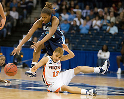 Virginia guard Britnee Millner (12) is knocked down by Old Dominion forward Jessica Canady (24) while battling for a loose ball.  The #11 ranked / #5 seed Old Dominion Lady Monarchs defeated the #24 ranked / #4 seed Virginia Cavaliers 88-85 in overtime in the second round of the 2008 NCAA Women's Basketball Championship at the Ted Constant Convocation Center in Norfolk, VA on March 25, 2008.