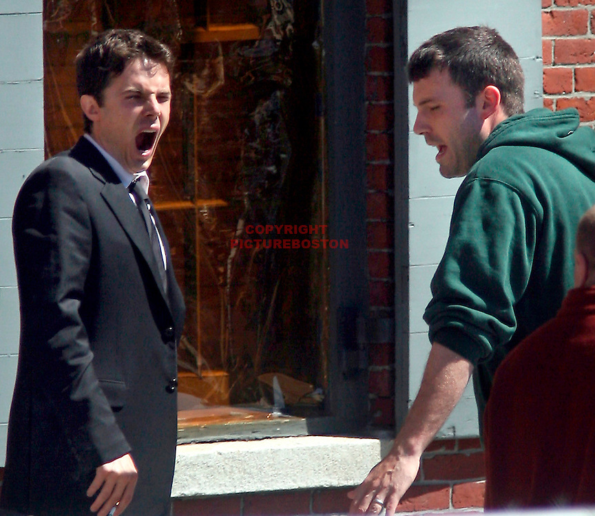 "(05/22/06-Boston,MA)  First day of shooting for Ben and Casey Affleck.....On Boston's waterfront (The Chart House Restaurant)....Ben directs his brother Casey during a quick break in filming of ""Gone Baby Gone""(052206affleckmg-Staff Photo:Mark Garfinkel.saved phto1/tues)"