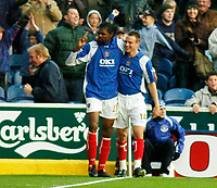 Photo: Gareth Davies.<br />Portsmouth v Everton. The Barclays Premiership. 09/12/2006.<br />Kanu (L) celebrates after putting Portsmouth 2-0 up.
