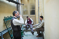 SLIEMA, MALTA - 8 FEBRUARY 2016: Actors of Shakespeare's Globe theatre company have a break during the intermission of touring Hamlet they perform, at the Salesian Theatre in Sliema, Malta, on February 8th 2016.<br /> <br /> The touring Hamlet, performed by the Shakespeare's Globe theatre company, is part of the Globe to Globe tour that set off in April 2014 (on the 450th anniversary of Shakespeare's birth) with the ambitious intention of visiting every country in the world over 2 years. The crew is composed of a total of sixteen men and women: four stage managers and twelve twelve actors  actors perform over two dozen parts on a stripped-down wooden stage. So far Hamlet has been performed in over 150 countries, to more than 100,000 people and travelled over 150,000 miles. The tour was granted UNESCO patronage for its engagement with local communities and its promotion of cultural education. Hamlet was also played for many dsiplaced people around the world. It was performed in the Zaatari camp on the border between Syria and Jordan, for Central African Republic refugees in Cameroon, and for Yemeni people in Djibouti. On February 3rd it was performed to about 300 refugees in Calais at the camp known as the Jungle.