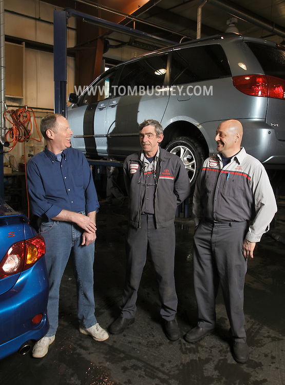 Newburgh Toyota service technician Allan Ball, left, stands next to foreman Brian Colt and foreman Mike Shipman in the service area on Tuesday, Feb. 23, 2010. When Ball suffered a heart attack at the New York dealership on Nov. 24, 2009, Colt and Shipman gave him CPR.