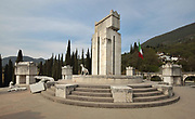 Mausoleum, with the tomb of D'Annunzio, on the Mastio hill at Vittoriale degli italiani, or The Shrine of Italian Victories, the home, estate and museums of Gabriele D'Annunzio, 1863-1938, Italian writer, soldier and fascist, at Gardone Riviera, Lake Garda, Brescia, Lombardy, Italy. The funeral monument was designed by Gian Carlo Maroni after d'Annunzio's death, in the style of Etruscan-Roman grave sites, with 3 marble circles representing the victories of the Humble, the Sappers and the Heroes. At the centre is the tomb of d'Annunzio surrounded by 10 other heroes of Fiume including Guido Keller, Giuseppe Piffer, Ernesto Cabruna and Gian Carlo Maroni. In 2013 iron and cement dog sculptures by Velasco Vitali were added. Picture by Manuel Cohen