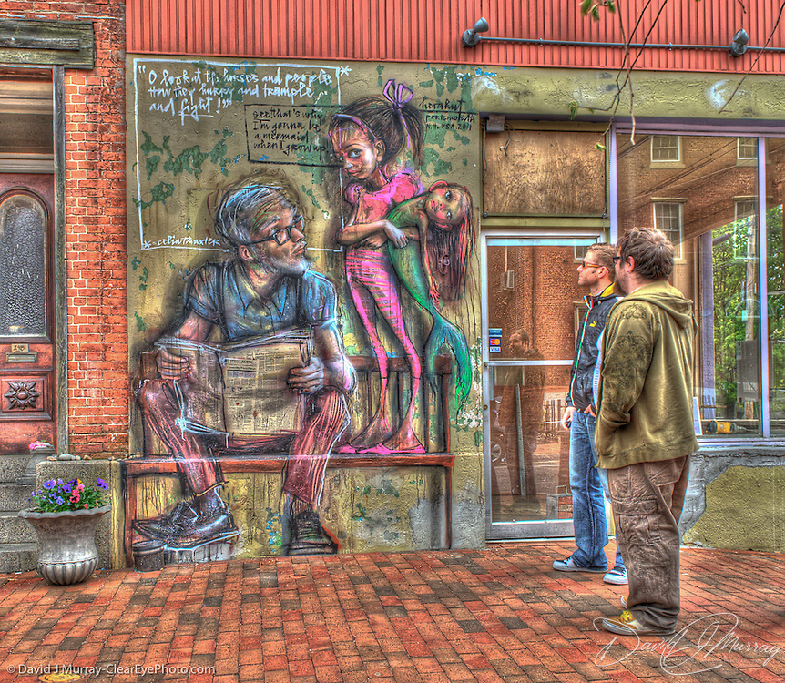 """Visitors admire Front panel of """"Mermaid"""" by street art duo Herakut, on State St. in downtown Portsmouth, NH"""