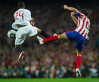 BARCELONA, SPAIN - MAY 19: Konko (L) of Sevilla and Antonio Lopez of Atletico de Madrid competes for the ball during the Copa del Rey final between Atletico de Madrid and Sevilla at Camp Nou stadium on May 19, 2010 in Barcelona, Spain. Sevilla won 2-0.  (Photo by Manuel Queimadelos Alonso/Getty Images) *** Local Caption *** Konko; Antonio Lopez