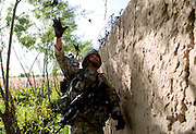 Sargeant Lawrence Buckius of the 82nd Airborne's, 1/508 PIR, Alpha Company, Third Platoon and a teammate toss grenades into an enemy compound near Sangin, Helman province on Wednesday, April 11, 2007.