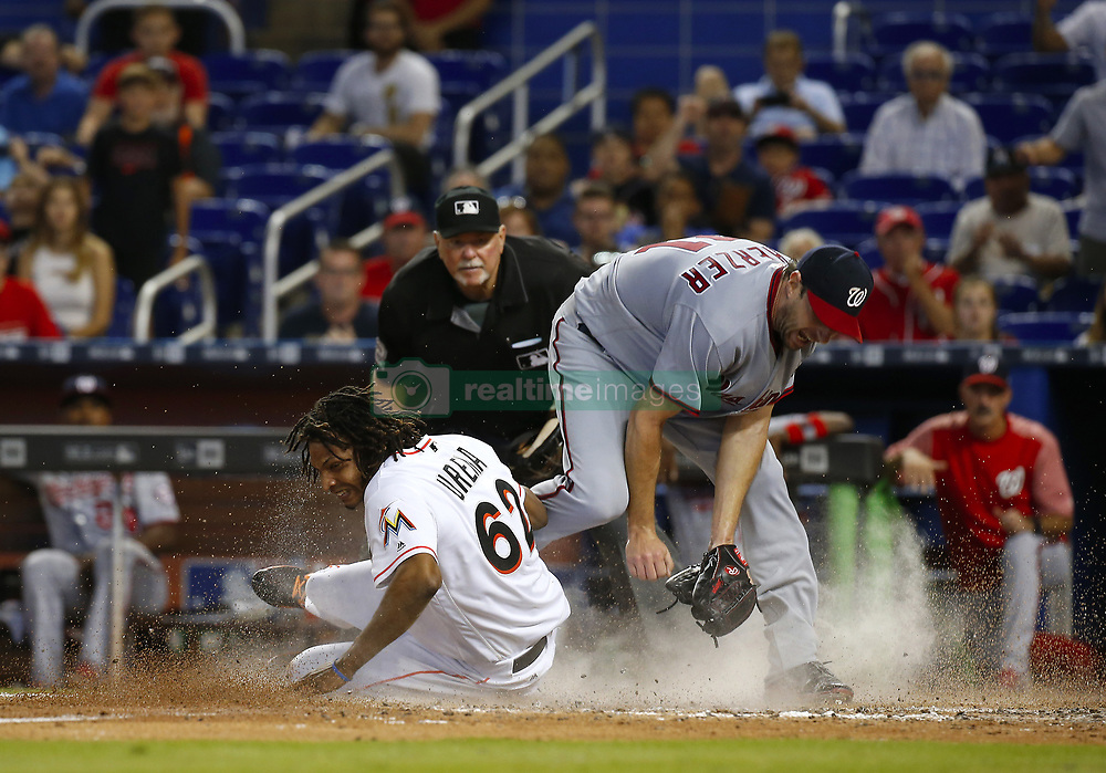 June 21, 2017 - Miami, FL, USA - Miami Marlins pinch runner Jose Urena scores after a wild pitch by Washington Nationals pitcher Max Scherzer during the eighth inning on Wednesday, June 21, 2017 at Marlins Park in Miami, Fla. (Credit Image: © David Santiago/TNS via ZUMA Wire)