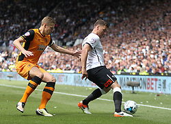Michael Dawson of Hull City (L) and Chris Martin of Derby County in action - Mandatory by-line: Jack Phillips/JMP - 14/05/2016 - FOOTBALL - iPro Stadium - Derby, England - Derby County v Hull City - Sky Bet Championship Play-Off Semi-Final First-Leg