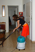A young teen cleaning house