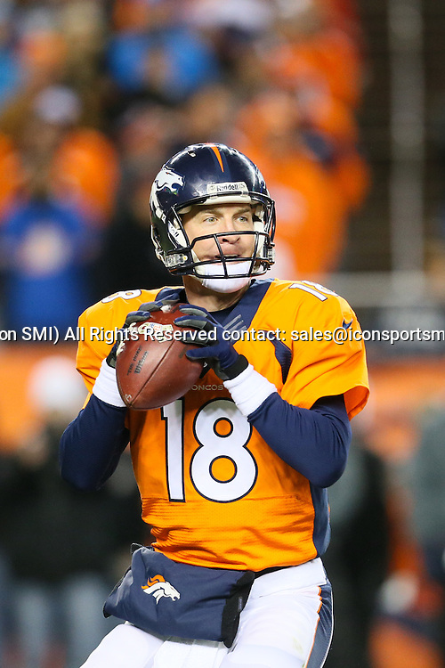 17 November 2013: Denver Broncos quarterback Peyton Manning (18) passes the ball during a game between the Denver Broncos and the Kansas City Chiefs at Sports Authority Field at Mile High, Denver, CO.