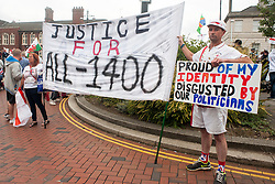 "Rotherham England<br /> 13 September 2014 <br /> EDL supporters outside Rotherham Town Hall before the start of the English Defence Leagues Justice for the Rotherham 1400 March on Saturday Afternoon described by an EDL Facebook Page as ""a protest against the Pakistani Muslim grooming gangs"" on Saturday Afternoon <br /> <br /> <br /> Image © Paul David Drabble <br /> www.pauldaviddrabble.co.uk"