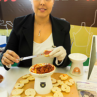 A woman prepares some nduja from Calabria, a spicy sausage, at one  of the stands of the Biennale del Gusto. The Biennale del Gusto is an exhibition held over four days, dedicated to traditional food and drinks from all regions of Italy.
