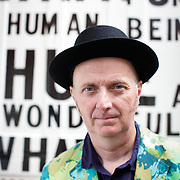 Artist who goes by the name 'Bob and Roberta Smith' photographed at home in East London before his Art Party event at the ICA. Photograph by Mark Chilvers