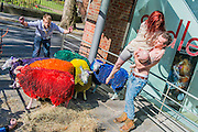 Latitude's coloured sheep and ballet dancers at Sadlers Wells Theatre - to celebrate the 10th anniversary of Latitude Festival, the famous multi-coloured sheep were brought from Suffolk to London. They performed with two dancers, Shaun Dillon and Kim Collins.  Sadler's Wells have helped to make Latitude into the biggest multi-arts festival. This summer the theatre returns for an eighth consecutive year, presenting a diverse programme on the outdoor Waterfront Stage. The Festival runs from 16-19th July at Henham Park. The images are EMBARGOED, to go out with Latitude Festival's arts announcement which will run in the press from 12am on 23.04.15 – the images can therefore be used for print on the 23rd (ie go to papers the afternoon before with this embargo) and can only be used on-line from 00:01 on Thurs 23rd.  Latitude announces the dance and theatre line up at 9am on Thursday 23rd March