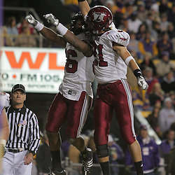 15 November 2008: Troy defensive back Sam Sellers (36) celebrates with teammate Troy defensive back Dujuan White (21) after Sellers scored on an interception return for a touchdown during the first half of the NCAA football game between the Troy Trojans and the LSU Tigers at Tiger Stadium in Baton Rouge, LA.
