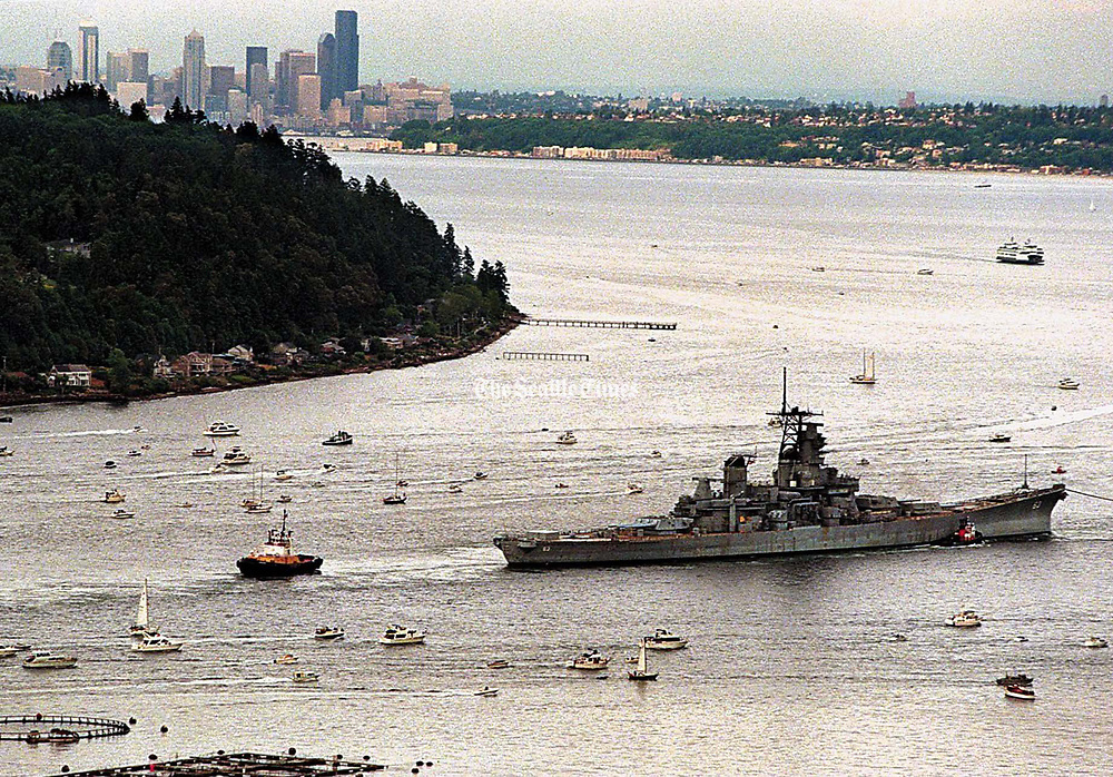 The battleship Missouri is escorted by a convoy of pleasure craft as it is towed around Bainbridge Island on its way to Hawaii. (Greg Gilbert / The Seattle Times, 1998)