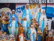 18 SEPTEMBER 2016 - BANGKOK, THAILAND: Statues of the Virgin Mary for sale at Santa Cruz Church before the church's 100th anniversary mass. Santa Cruz Church was establised in 1769 to serve Portuguese soldiers in the employ of King Taksin, who reestablished the Siamese (Thai) empire after the Burmese sacked the ancient Siamese capital of Ayutthaya. The church was one of the first Catholic churches in Bangkok and is one of the most historic Catholic churches in Thailand. The first sanctuary was a simple wood and thatch structure and burned down in the 1800s. The church is in its third sanctuary and was designed in a Renaissance / Neo-Classical style. It was consecrated in September, 1916. The church, located on the Chao Phraya River, serves as a landmark for central Bangkok.       PHOTO BY JACK KURTZ