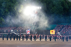© Licensed to London News Pictures. 13/06/2013. London, UK. Performing for Her Majesty the Queen, reenactors of the Napoleonic Association stage a mock battle celebrating the British Army's 1813 victory at the Battle of Vitoria as they take in the annual Beating Retreat parade at Horse Guards Parade in London. On two successive evenings each year in June a pageant of military music, precision marching and colour takes place on Horse Guards Parade in the heart of London when the Massed Bands of the Household Division carry out the Ceremony of Beating Retreat. 300 musicians, drummers and pipers perform this age-old ceremony. The Retreat has origins in the early days of chivalry when beating or sounding retreat pulled a halt to the days fighting. Photo credit: Matt Cetti-Roberts/LNP