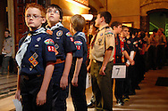 5 FEB. 2012 -- ST. LOUIS  -- Jacob Bessler (left), a Cub Scout from Holy Infant Parish in Ballwin, Mo., waits to lead Cub Scouts, Boy Scouts and Venture Scouts into the Cathedral Basilica of St. Louis for a Scout Sunday prayer service led by the Most Rev. Edward F. Rice, Auxiliary Bishop of the Archdiocese of St. Louis Sunday, Feb. 5, 2012. Photo © copyright 2012 Sid Hastings.