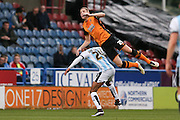 Hull City defender Michael Dawson (21) flies through the air during the Sky Bet Championship match between Huddersfield Town and Hull City at the John Smiths Stadium, Huddersfield, England on 9 April 2016. Photo by Simon Davies.