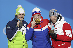 PYEONGCHANG-GUN, SOUTH KOREA - FEBRUARY 16: (L-R) Silver medalist Jakov Fak of Slovenia, gold medalist Johannes Thingnes Boe of Norway and bronze medalist Dominik Landertinger of Austria celebrate during the Medal Ceremony for Biathlon - Men's 20km Individual on day seven of the PyeongChang 2018 Winter Olympic Games at Medal Plaza on February 16, 2018 in Pyeongchang-gun, South Korea.  Photo by Chine Nouvelle/SIPA