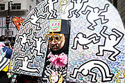 New York, NY - 21 April 2019. A man with a Keith-Haring-=styled headdress at the Easter Bonnet Parade and Festival on New York's Fifth Avenue.