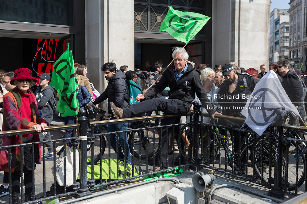 Climate Change protestors with Extinction Rebellion block Oxford Circus and simultaneously stop traffic across central London including Marble Arch, Piccadilly Circus, Waterloo Bridge and roads around Parliament Square, on 15th April 2019, in London, England.