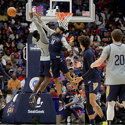 Oct 5, 2019; New Orleans, LA, USA; New Orleans Pelicans forward Brandon Ingram (14) blocks a dunk attempt by forward Zion Williamson (1) during a open practice at the Smoothie King Center. Mandatory Credit: Derick E. Hingle-USA TODAY Sports