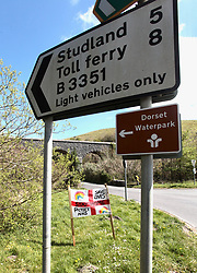 Covid 19 - homemade sign on road leading to popular Dorset beaches during Coronavirus lockdown. UK April 2020