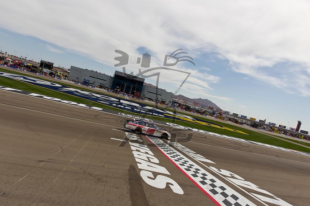 LAS VEGAS, NV - MAR 11, 2012:  Dale Earnhardt, Jr. (88) crosses the finish line at the Kobalt Tools 400 NASCAR race in Las Vegas, NV.