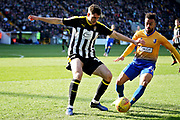 Notts County defender Sam Stubbs (18) and Mansfield Town forward Nicky Ajose (21) during the EFL Sky Bet League 2 match between Notts County and Mansfield Town at Meadow Lane, Nottingham, England on 16 February 2019.