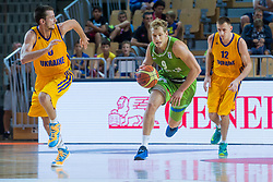 Jaka Blazic of Slovenia vs Olexandr Mishula of Ukraine during friendly basketball match between National teams of Slovenia and Ukraineat day 1 of Adecco Cup 2015, on August 21 in Koper, Slovenia. Photo by Grega Valancic / Sportida