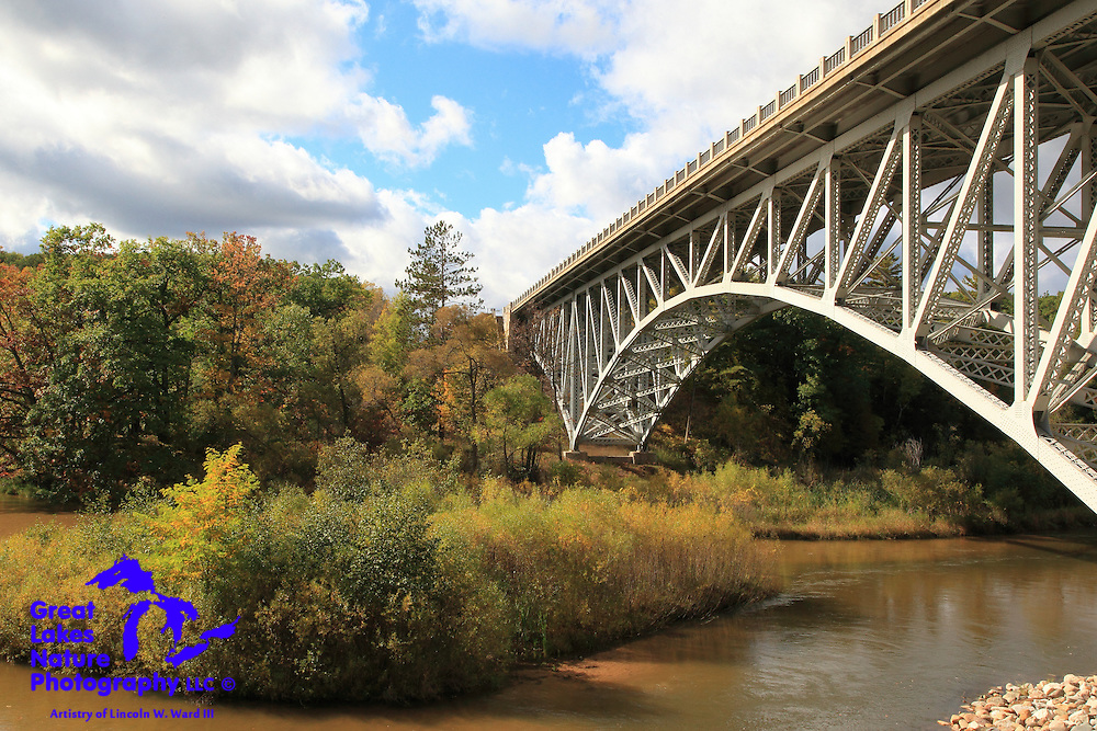 This is the Mortimer E. Cooley Bridge, which carries Michigan highway M-55 over the Pine River near Wellston. This is one of only two cantilevered deck truss bridges in Michigan, the other being the Cut River Bridge in the Upper Peninsula.