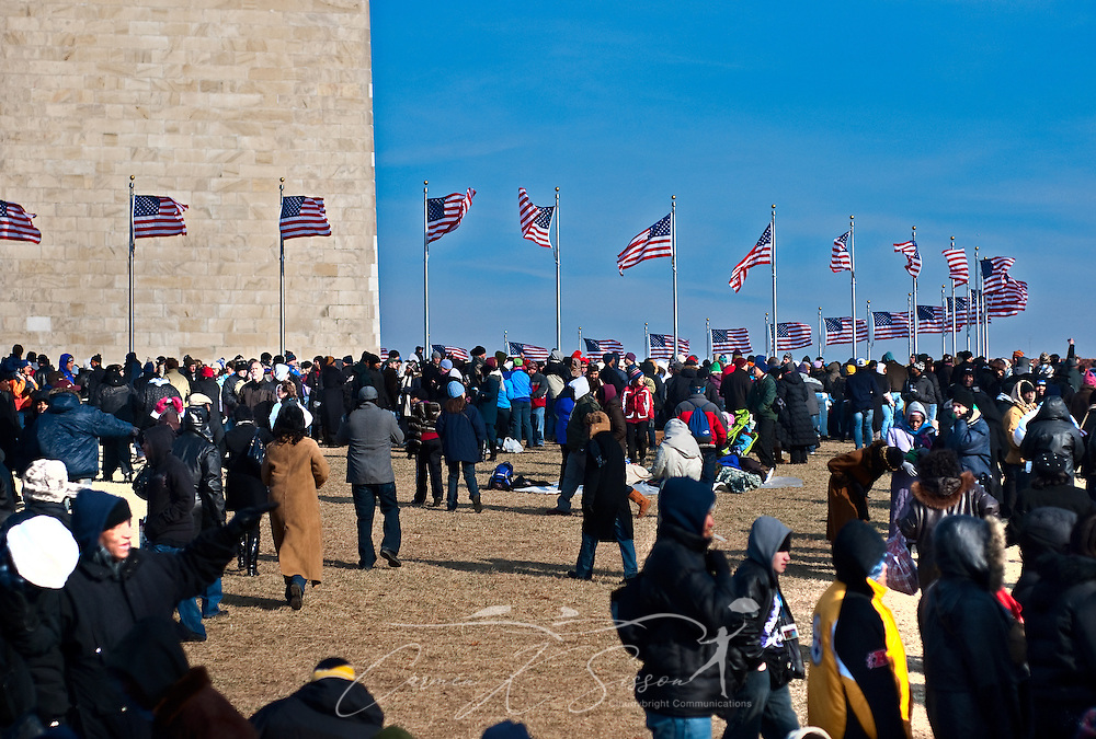 People gather near the Washington Monument in Washington D.C.'s National Mall to watch Barack Obama's inauguration Jan. 20, 2009. An estimated one million people attended the event. (Photo by Carmen K. Sisson/Cloudybright)