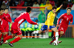 Nilmar of Brazil vs Cha Jong Hyok of North Korea during the 2010 FIFA World Cup South Africa Group G match between Brazil and North Korea at Ellis Park Stadium on June 15, 2010 in Johannesburg, South Africa. Brazil defeated Korea 2-1. (Photo by Vid Ponikvar / Sportida)