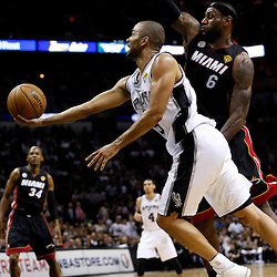 Jun 13, 2013; San Antonio, TX, USA; San Antonio Spurs point guard Tony Parker (9) shoots against Miami Heat small forward LeBron James (6) during the second quarter of game four of the 2013 NBA Finals at the AT&T Center. Mandatory Credit: Derick E. Hingle-USA TODAY Sports