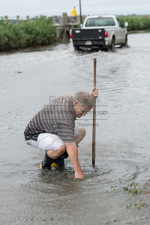Home owner Jim Simpson clears a blocked storm drain along the Battery in historic downtown after Hurricane Matthew passed through causing flooding and light damage to the area October 8, 2016 in Charleston, South Carolina. The hurricane made landfall near Charleston as a Category 2 storm but quickly diminished as it moved north.