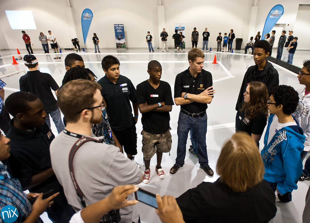 NASCAR Sprint Cup driver David Ragan talks with high school and middle school students from around the region at the NASCAR Research & Development Center in Concord Thursday morning. (Photo by James Nix)