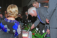 Nobel Laureate Seamus Heaney who is this year celebrating his 70th birthday ceremonially cuts a birthday cake, a gesture from his friends at Queen's University, Belfast, where he was a lecturer in Modern English Literature during the 60's. The occasion was a lunch followed by Heaney being interviewed by broadcaster William Crawley, also in the photograph. 200912023162.<br /> <br /> Copyright Image from Victor Patterson,<br /> 54 Dorchester Park, <br /> Belfast, UK, BT9 <br /> <br /> t1: +44 28 9066 1296 (from Rep of Ireland 048 90661296)<br /> t2: +44 28 9002 2446 (from Rep of Ireland 048 9002 2446)<br /> <br /> m: +44 7802 353836<br /> <br /> e: victorpatterson@me.com<br /> www.victorpatterson.com<br /> <br /> Please see my Terms and Conditions of Use at www.victorpatterson.com. It is IMPORTANT that you familiarise yourself with them.<br /> <br /> Images used on the Internet must be visibly watermarked i.e. © Victor Patterson<br /> within the body of the image and copyright metadata must not be deleted. Images <br /> used on the Internet have a size restriction of 4kbs and will be chargeable at current<br />  NUJ rates unless agreed otherwise.<br /> <br /> This image is only available for the use of the download recipient i.e. television station, newspaper, magazine, book publisher, etc, and must not be passed on to any third <br /> party. It is also downloaded on condition that each and every usage is notified within 7 days to victorpatterson@me.com<br /> <br /> The right of Victor Patterson to be identified as the author is asserted in accordance with The Copyright Designs And Patents Act (1988). All moral rights are asserted.
